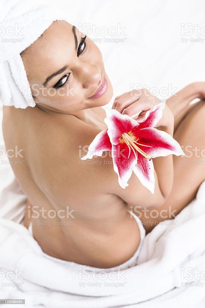 Smiling woman wearing towel royalty-free stock photo