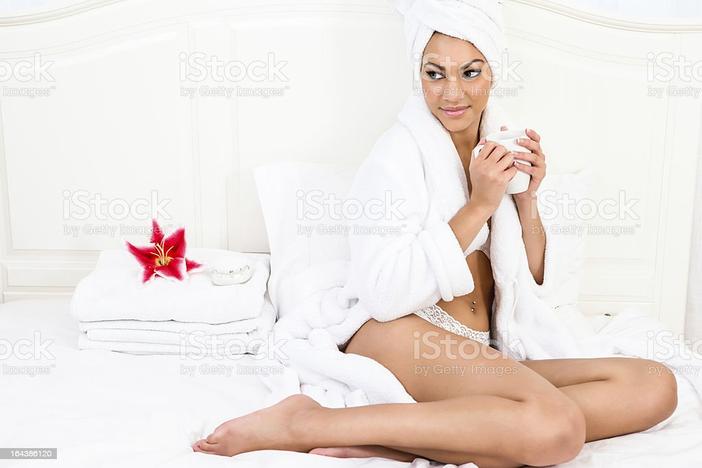 Smiling woman wearing towel with cup of coffee royalty-free stock photo