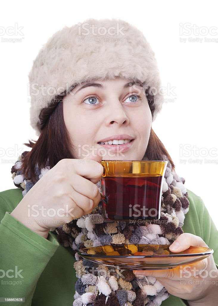smiling woman with a fur hat holding cup of tea royalty-free stock photo