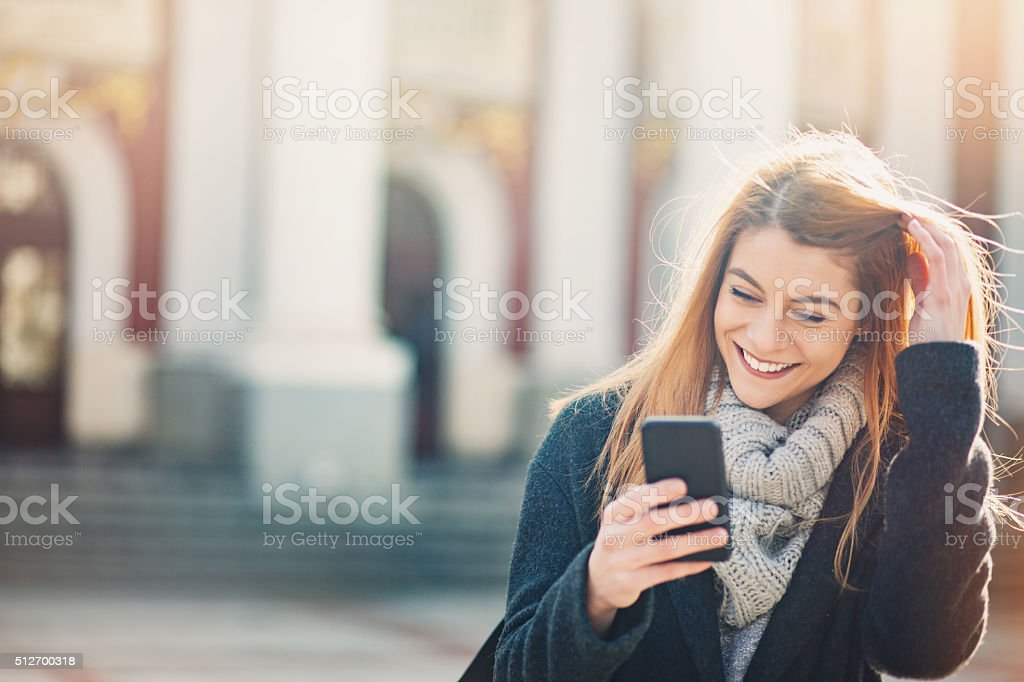 Smiling woman with a phone stock photo