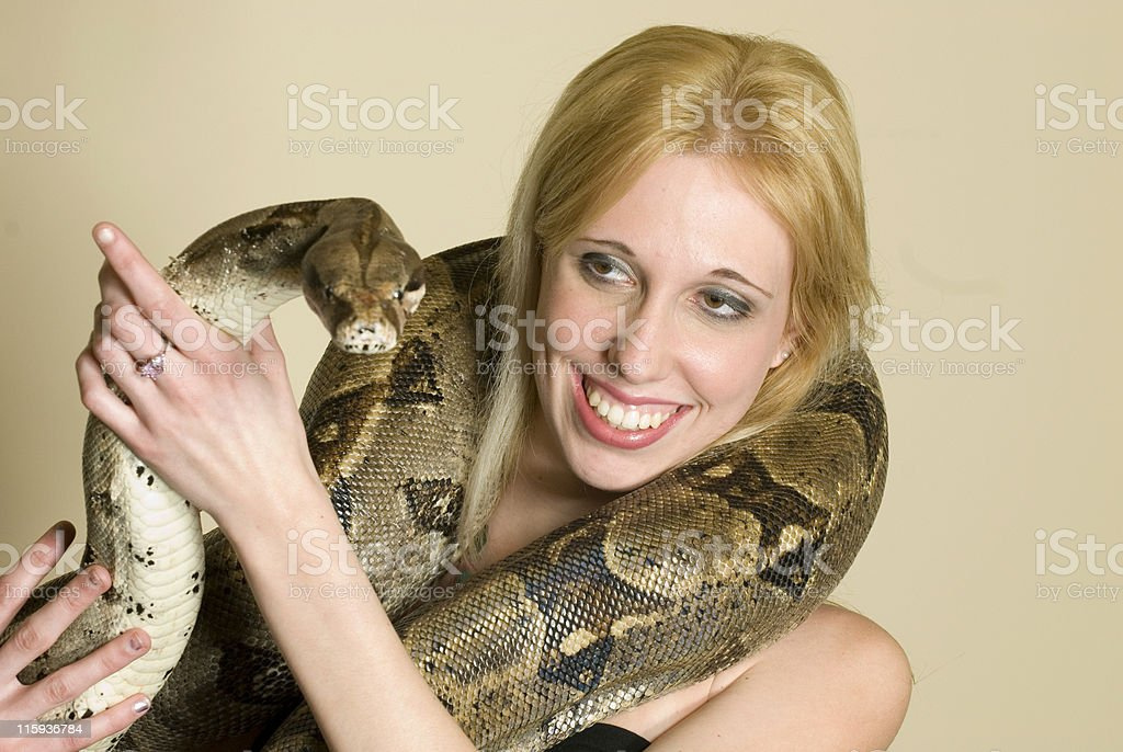 Smiling Woman with a Python royalty-free stock photo