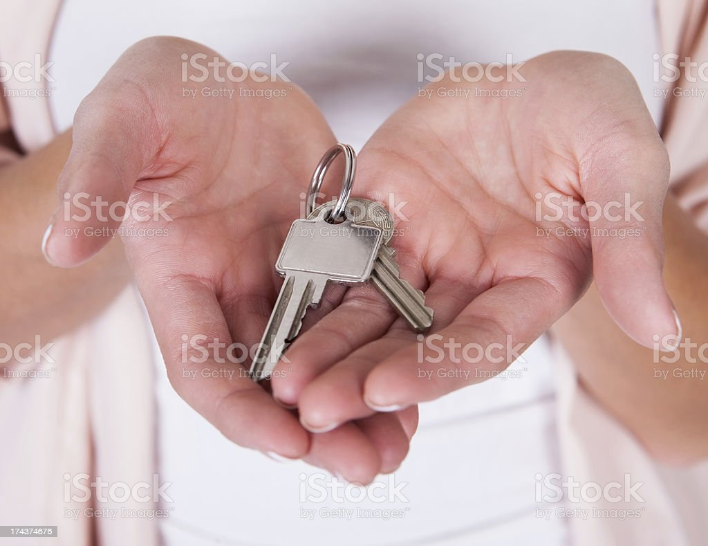 Smiling woman with a set of keys royalty-free stock photo