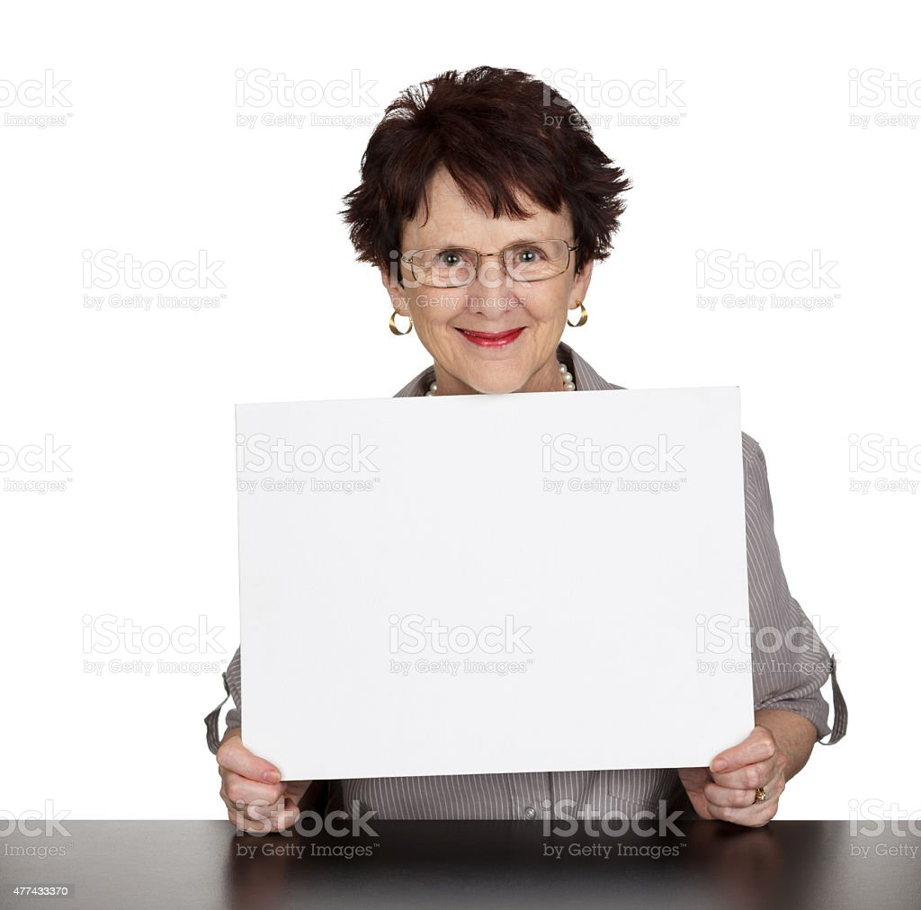 Smiling woman with blank sign stock photo