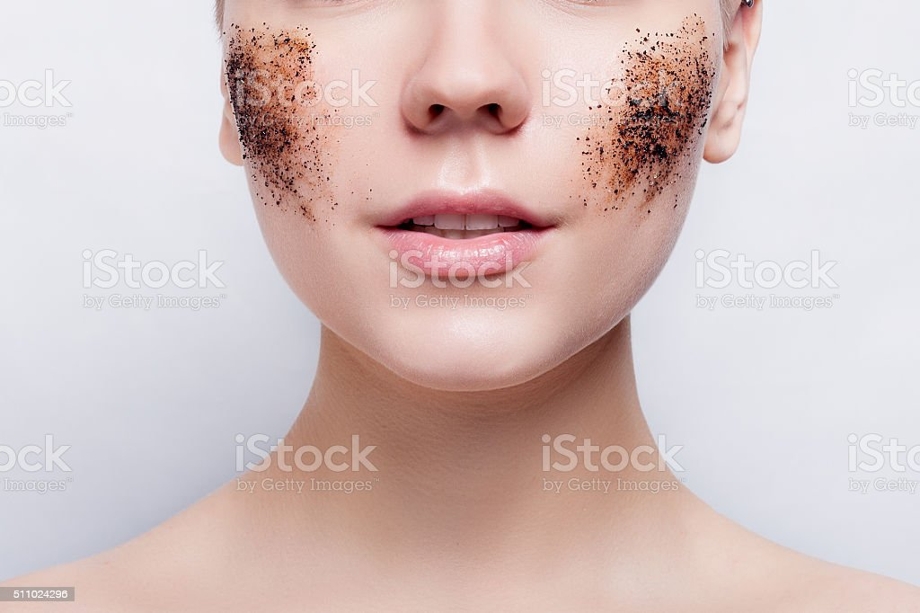 Smiling woman with cleans the skin coffee skrub stock photo