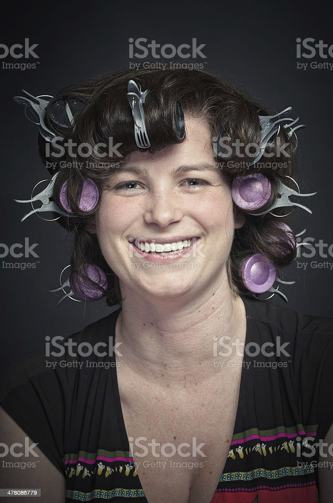 Smiling Woman with Curlers royalty-free stock photo