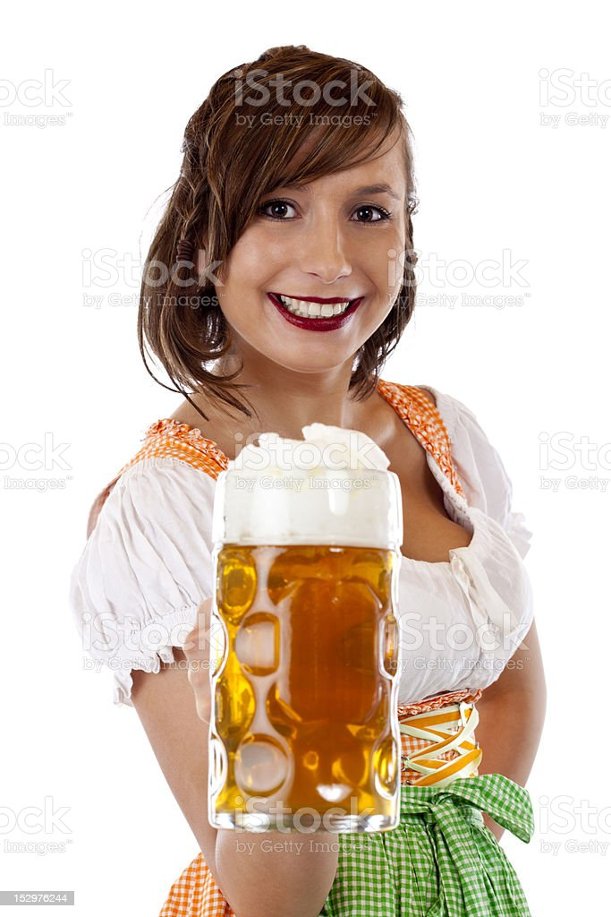 Smiling woman with dirndl  holds Oktoberfest beer stein royalty-free stock photo