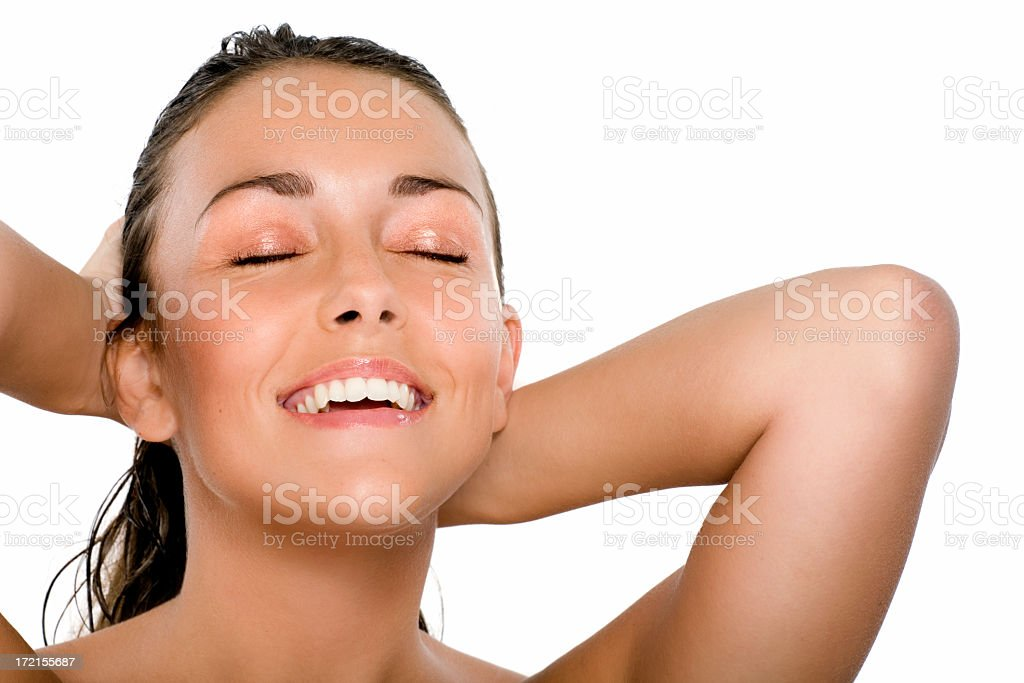 Smiling woman with eyes closed and hands on wet hair royalty-free stock photo