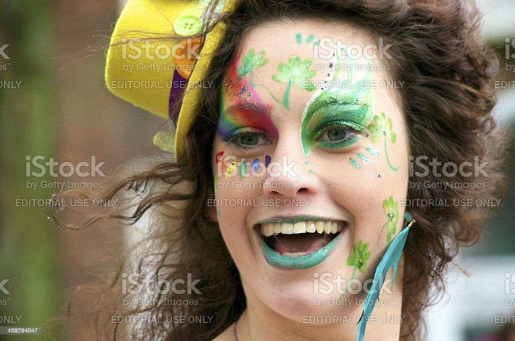 Smiling Woman with Facepaint in the St. Patrick's Day Parade royalty-free stock photo