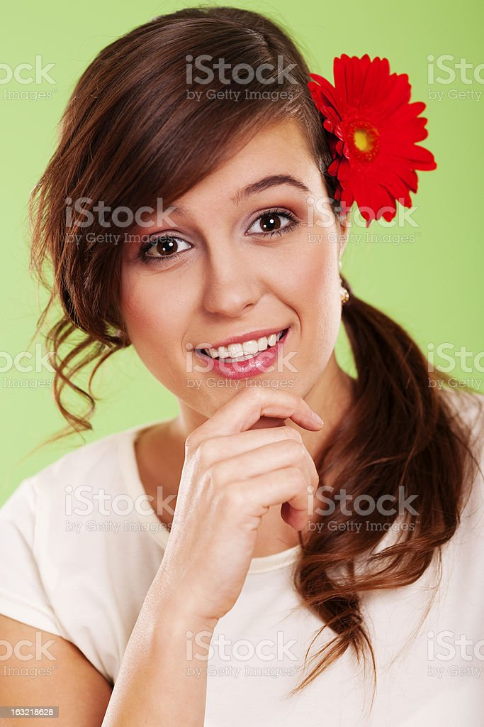 Smiling woman with flower in her hair royalty-free stock photo