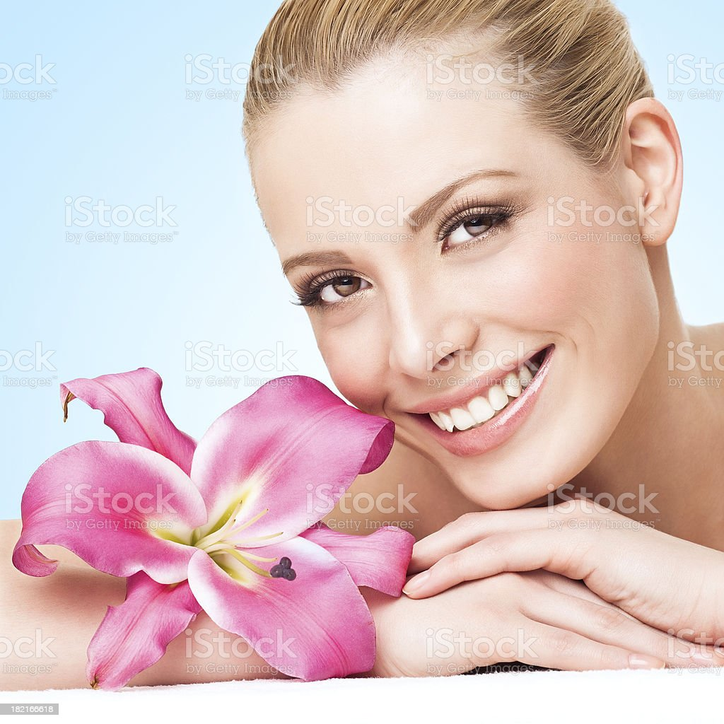 Smiling Woman With Flower royalty-free stock photo