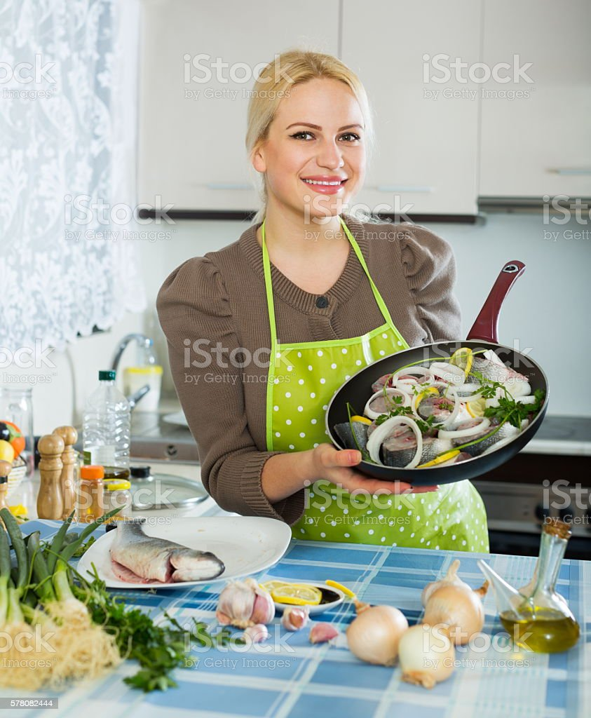 Smiling woman with frying pan stock photo