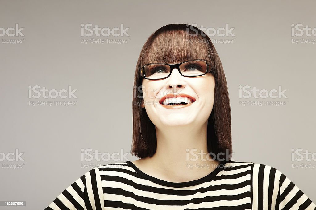 Smiling Woman with Glasses and Striped Shirt royalty-free stock photo