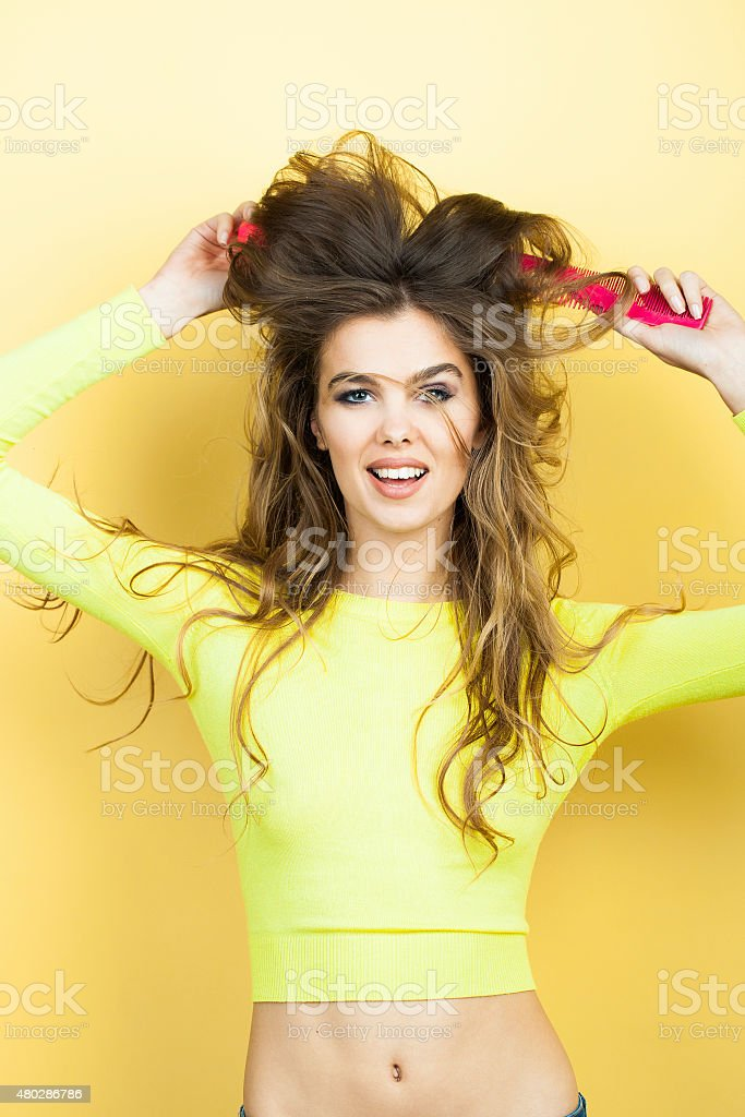 Smiling woman with hair brushes stock photo