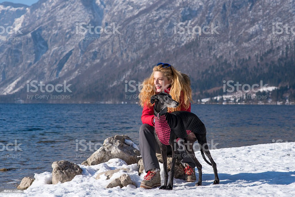Smiling woman with her dog stock photo