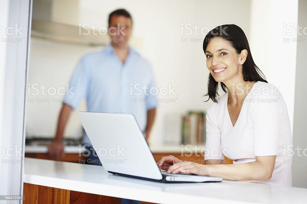 Smiling woman with laptop royalty-free stock photo
