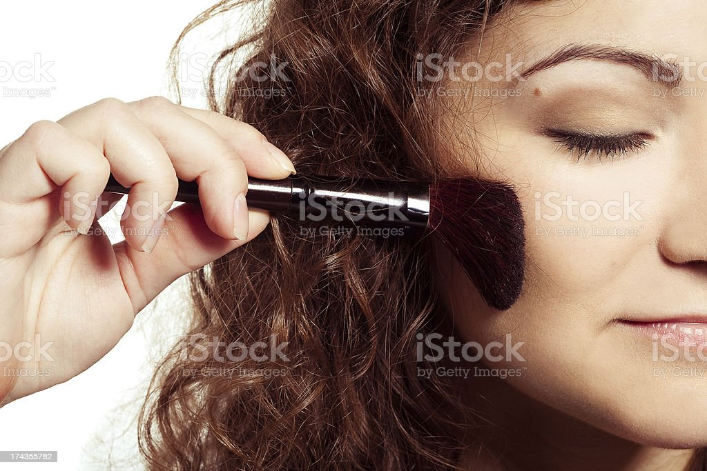 Smiling woman with make up tools royalty-free stock photo