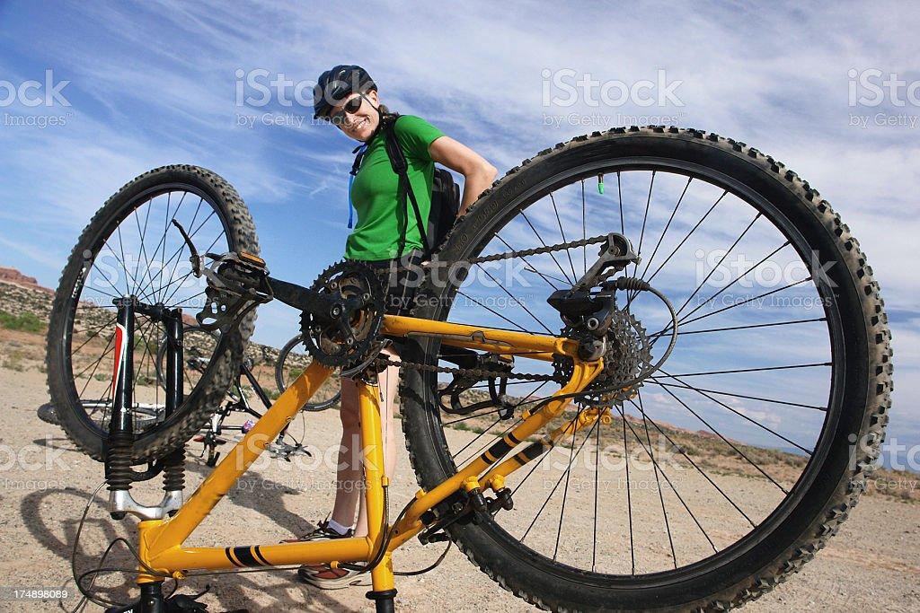 smiling woman with mountain bike stock photo