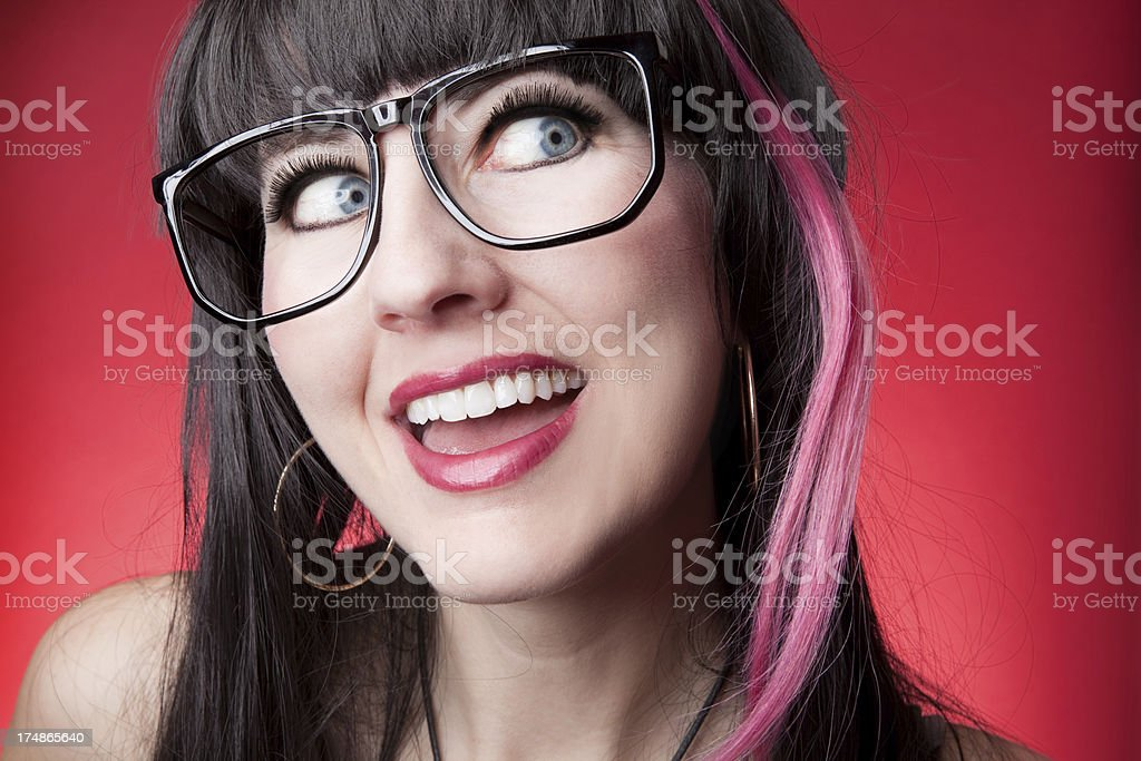 Smiling Woman With Nerd Glasses and Pink Hair royalty-free stock photo