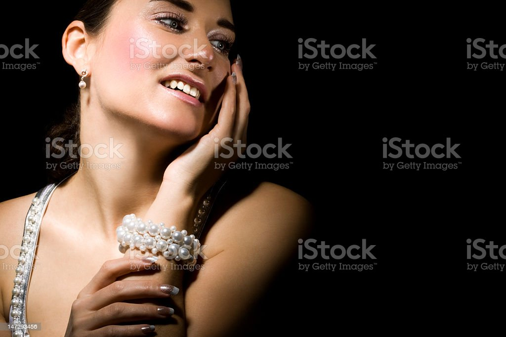 Smiling woman with pearls on her neck and wrist royalty-free stock photo