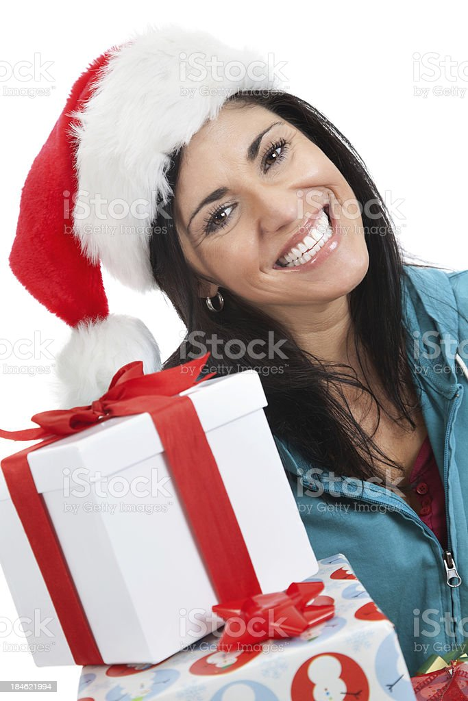 Smiling woman with Santa hat and Christmas presents royalty-free stock photo
