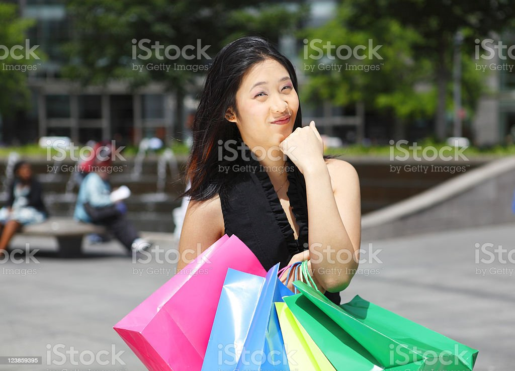 Smiling Woman with Shopping Bags royalty-free stock photo