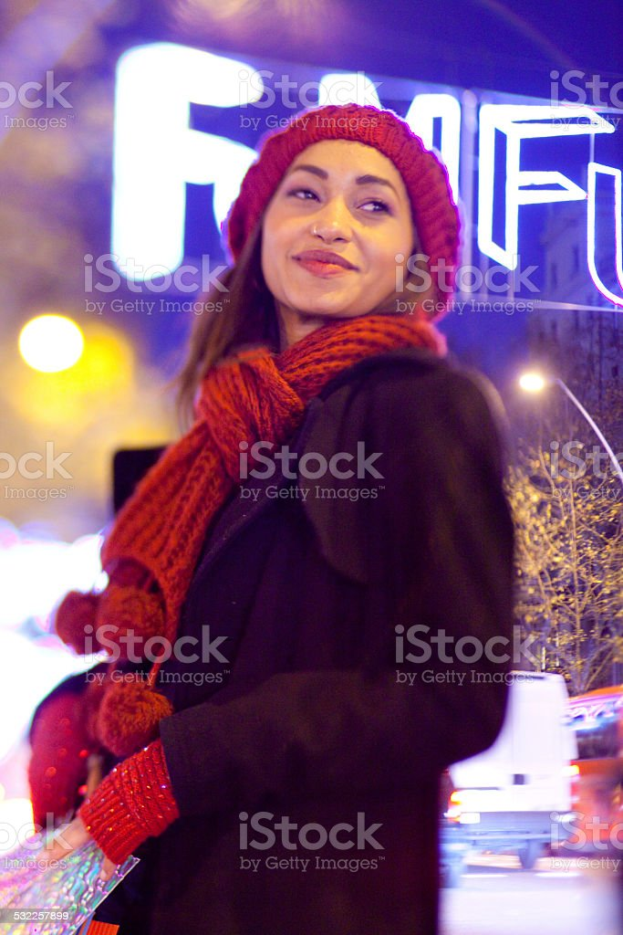 Smiling woman with shoppping bags stock photo