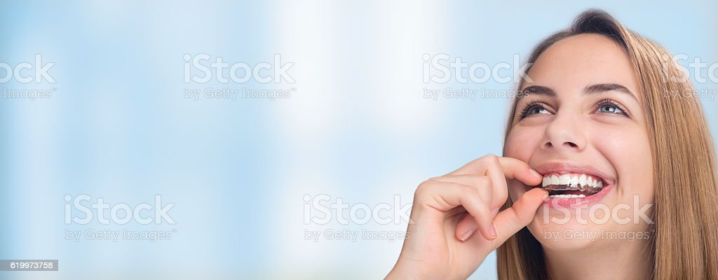 Smiling woman with silicone trainer close up. stock photo