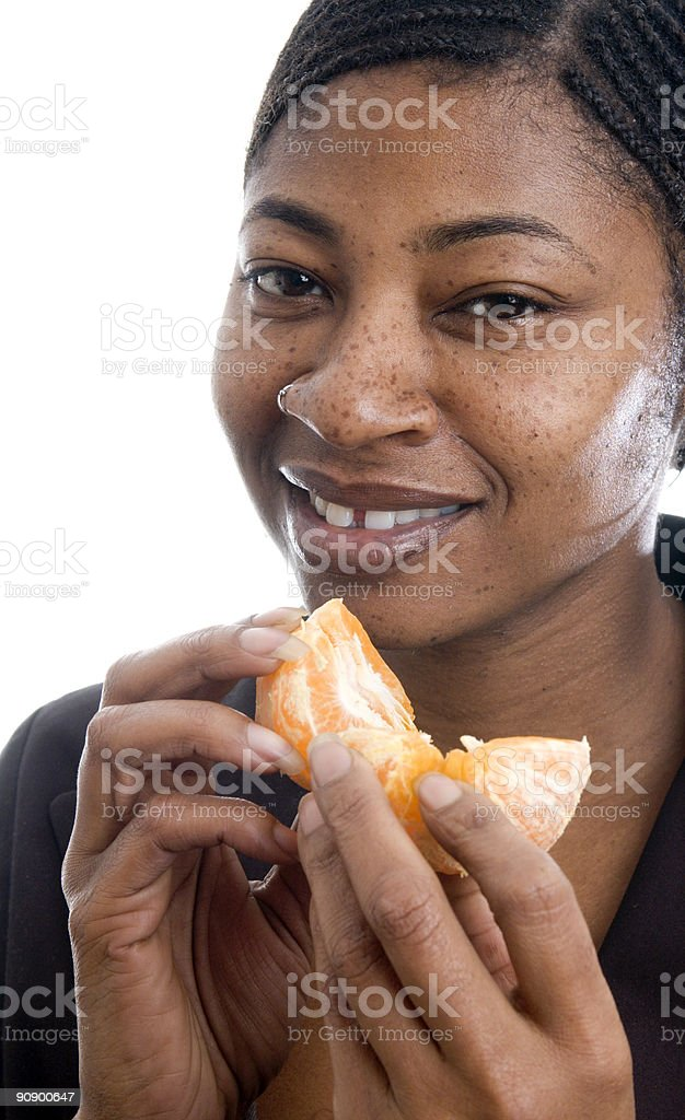 smiling woman with tangerine stock photo