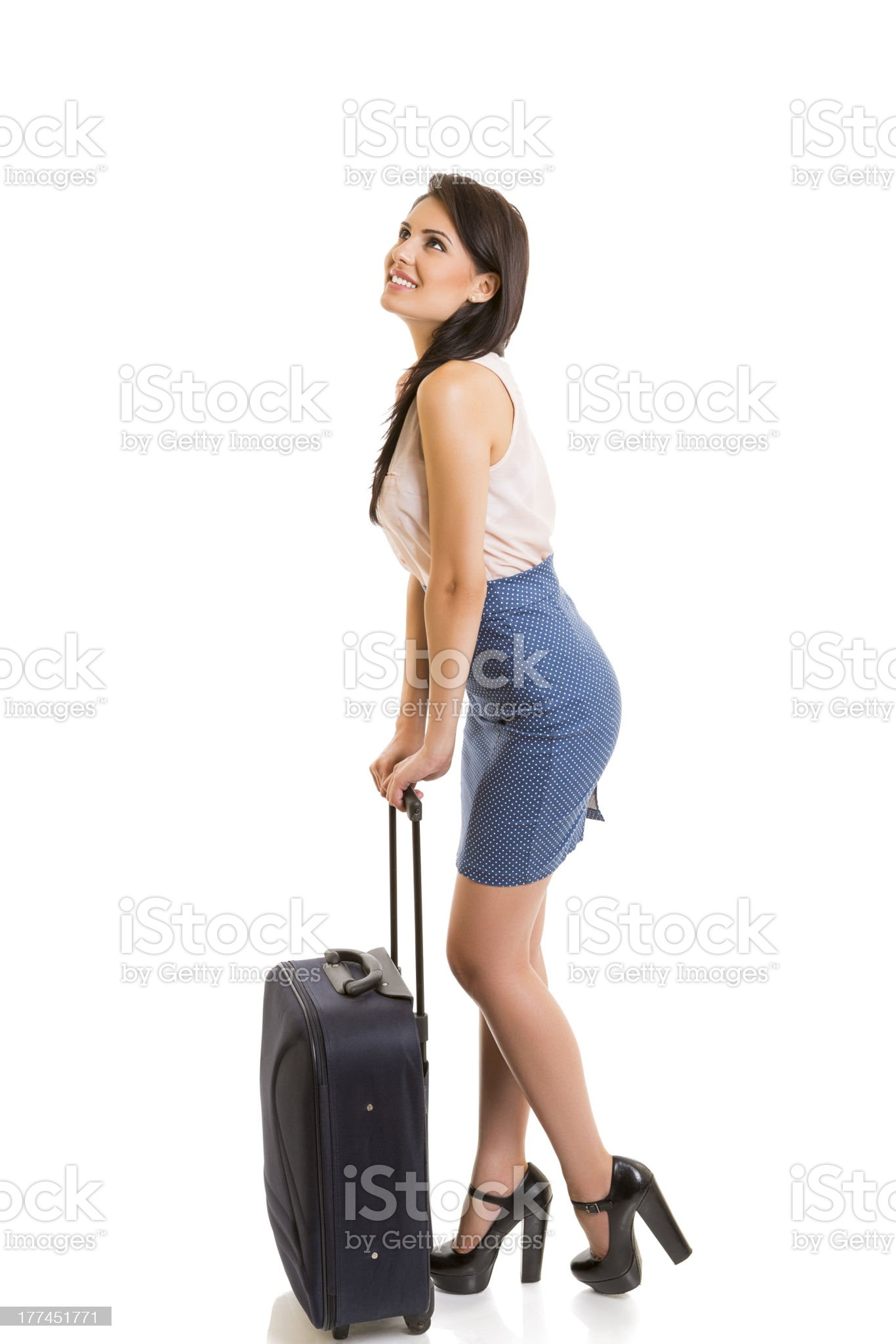 Smiling woman with travel luggage royalty-free stock photo