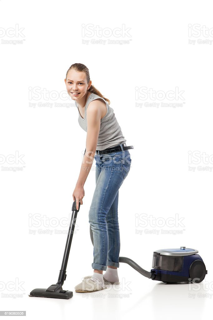 Smiling woman with vacuum-cleaner isolated stock photo