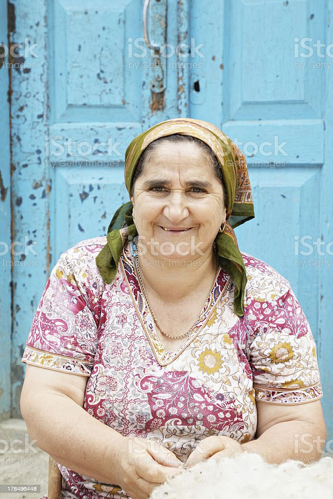 Smiling woman with wool royalty-free stock photo