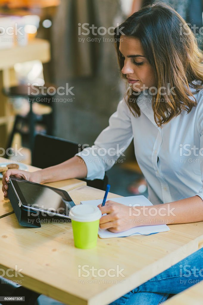 Smiling Woman Working In Her Cafe stock photo