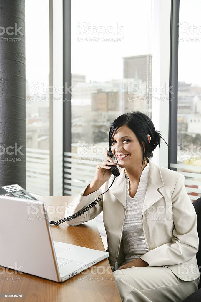 Smiling woman working royalty-free stock photo
