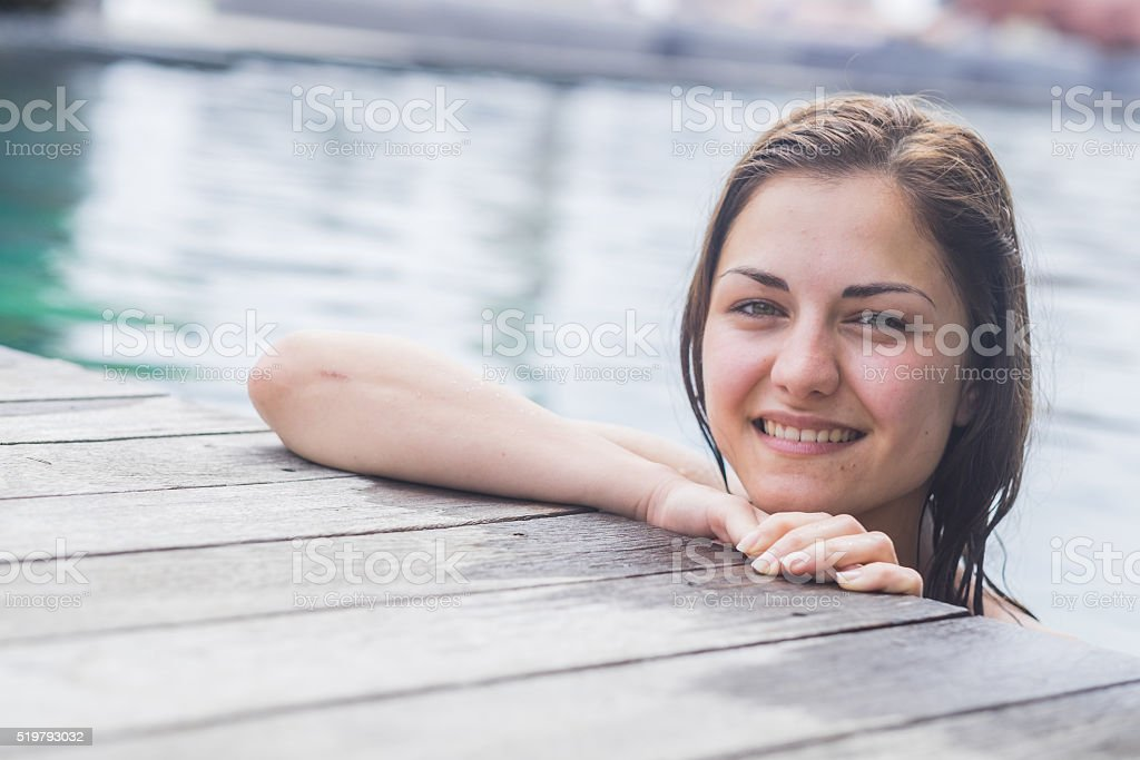 smiling women in the pool stock photo