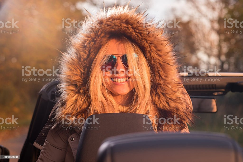 Smiling women posing in cabriolet stock photo