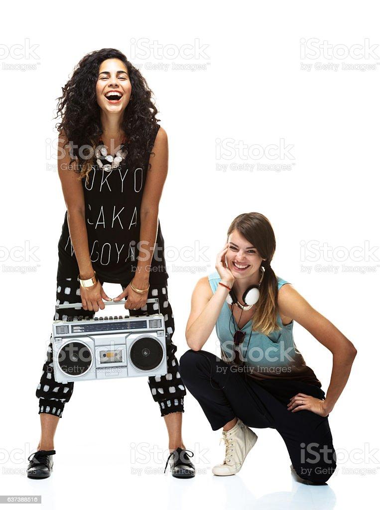 Smiling women standing and kneeling stock photo
