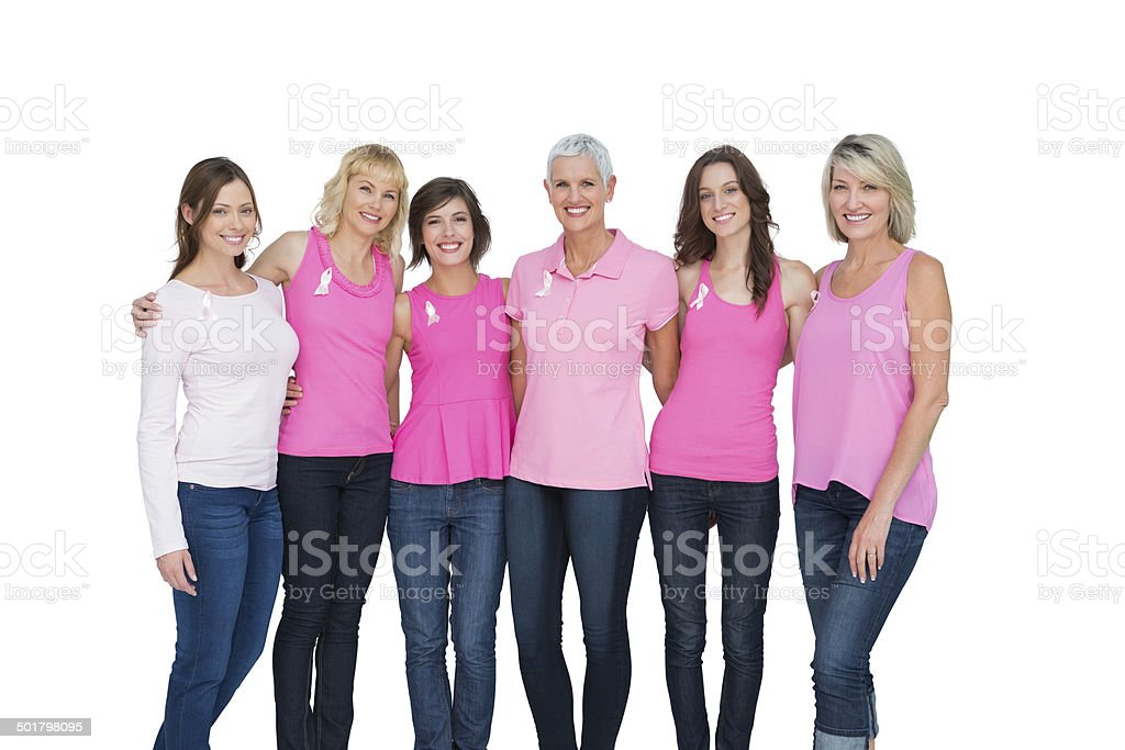 Smiling women wearing pink for breast cancer awareness stock photo