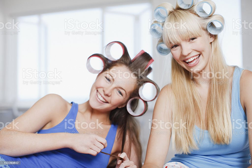 Smiling women with curlers in hair royalty-free stock photo