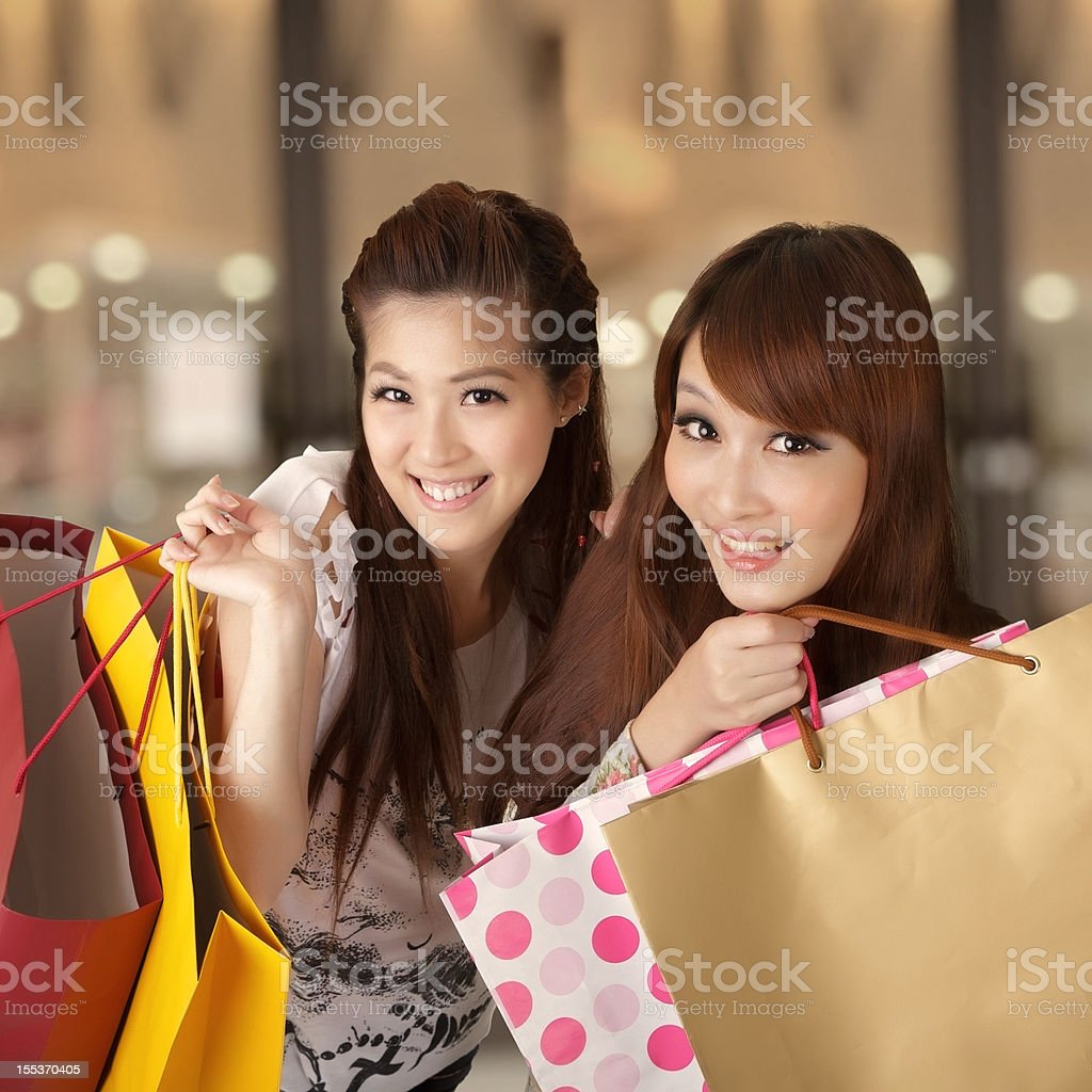 Smiling women with shopping bags royalty-free stock photo