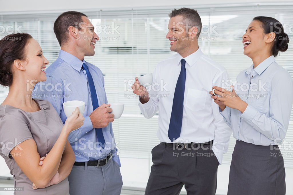 Smiling work team during break time stock photo