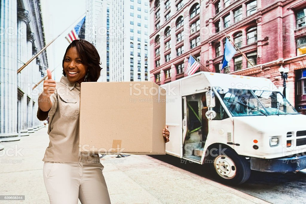 Smiling worker giving thumbs up outdoors stock photo