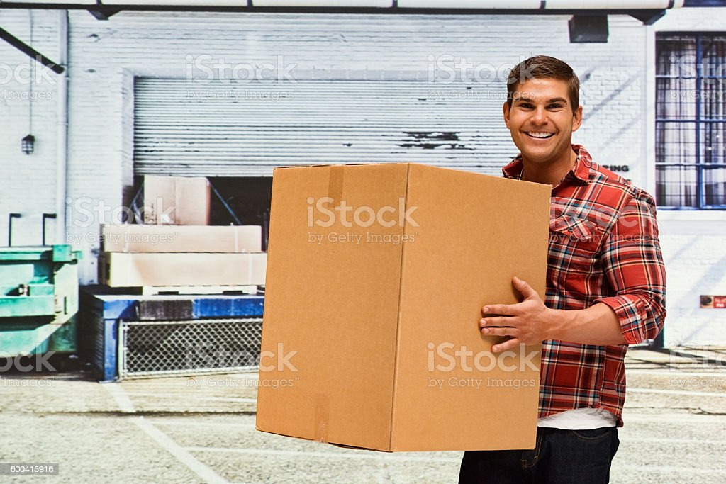 Smiling worker holding box stock photo