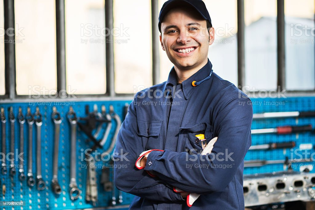 Smiling worker in front of his tools stock photo
