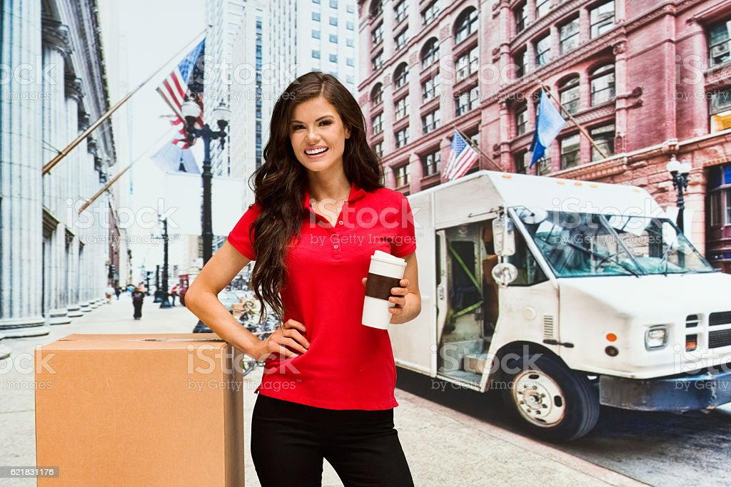 Smiling worker standing outdoors stock photo