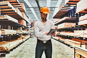 Smiling worker using tablet in warehouse