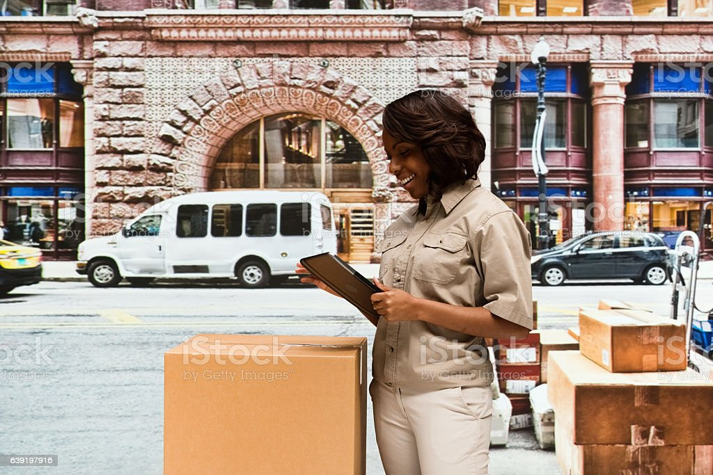 Smiling worker using tablet outdoors stock photo