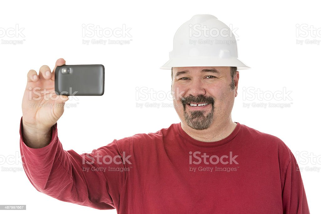 Smiling workman taking a self-portrait stock photo