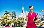 Smiling worshiper waving hand outdoors