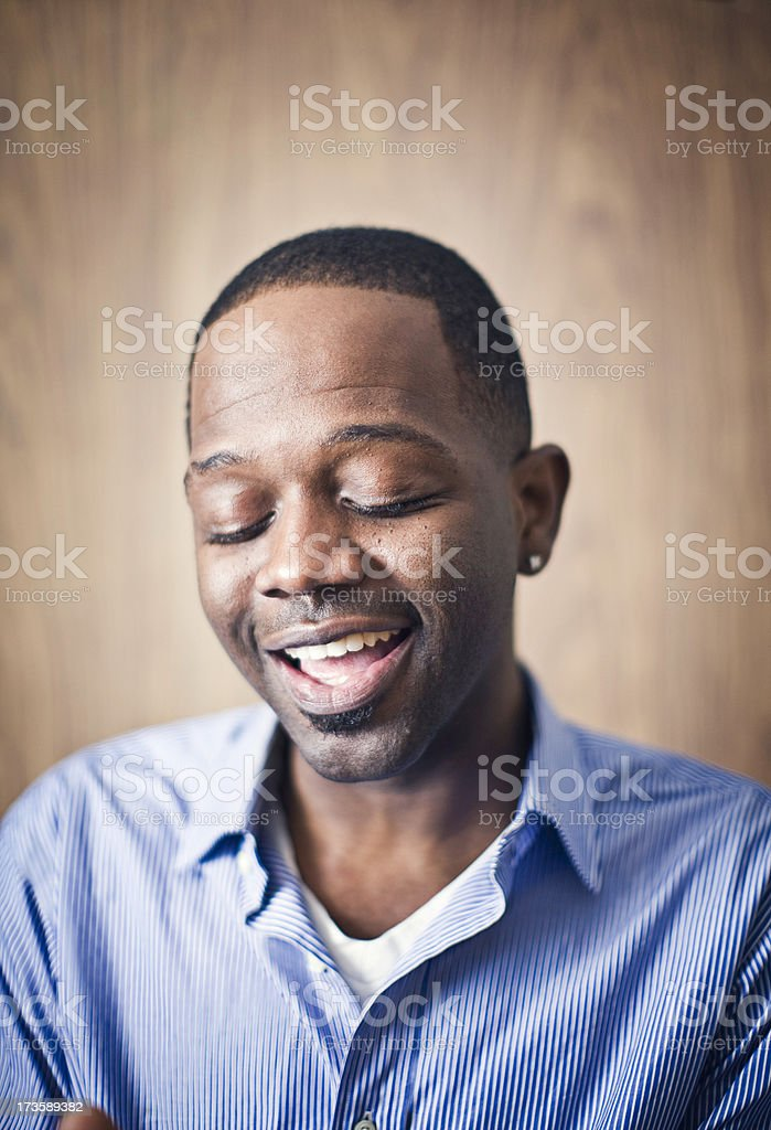 Smiling Young African American Man Praying royalty-free stock photo