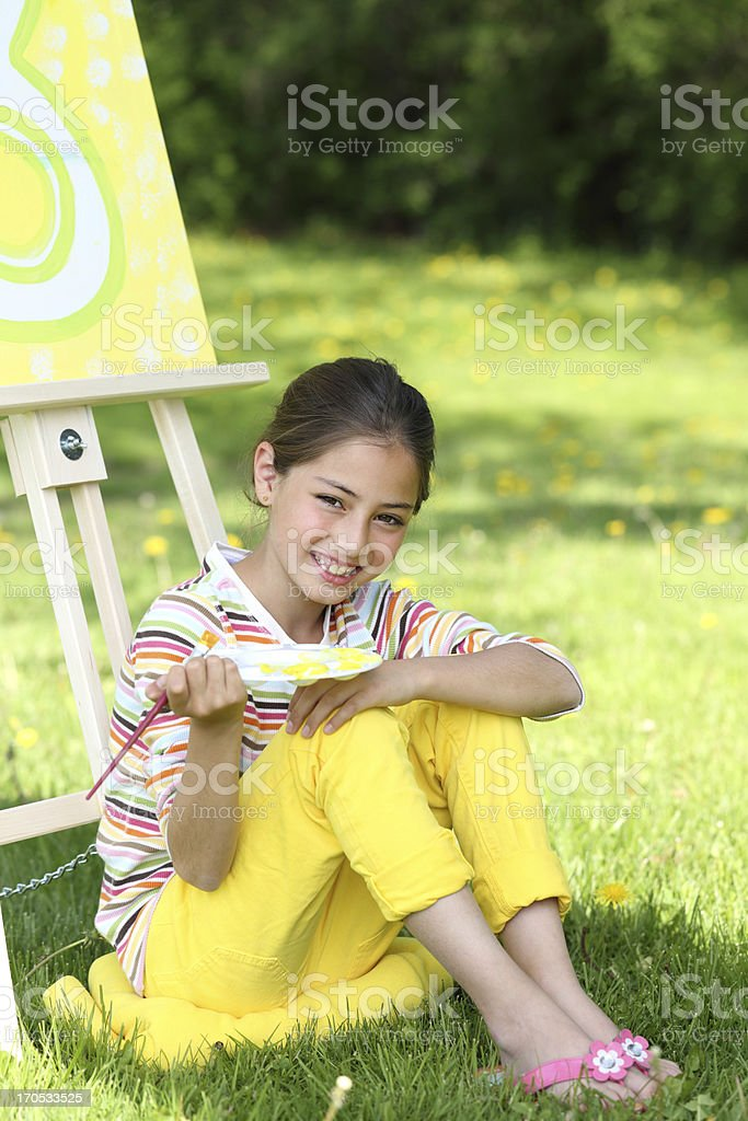 Smiling young artist stock photo